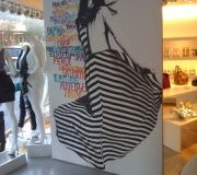 Customized walls make a big impact to this interior retail space, at Intermix, NY.