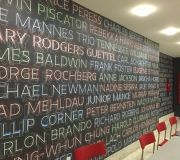 NYC college new branding campaign uses custom printed wall paper for entryway and lobby area .
