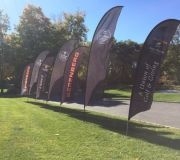 Sporting event graphics. Bow flags are great for outdoor branding of environments