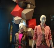 "For the fall windows roll out, multiple ""gem"" shapes were screen printed & fabricated to create window display."