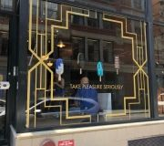Metallic gold cut vinyl creates eye catching window display for pop up store