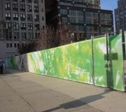 Art installation uses vinyl mesh to cover fence at construction site