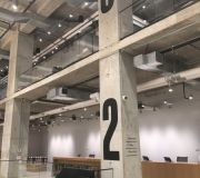 Wayfinding signage screen printed on concrete columns corporate interiors NYC