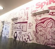 This space comes alive with wall mural and elevator wraps in corporate headquarters