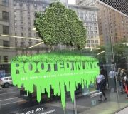 Window clings are enhanced by use of custom fabricated dimensional tree