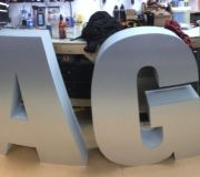 Custom dimensional letters are custom painted for trade show graphics