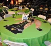 Sporting event uses branded table drops to promote product,