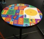 Vinyl can be used in many exciting ways . here, table to pis wrapped with vinyl for branding .