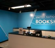 Vinyl printed wall mural for book store at United Nations adds a pop of color .