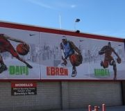 Outdoor large format printed mesh banners for retail application
