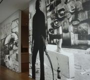 At this exhibition in MoMA, large black and white photos are digitally printed for wall murals.