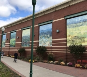 Color X custom fabricated aluminum frames and large format vinyl banners  transform this space into a outdoor art gallery
