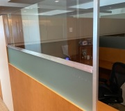 Half inch polished plexiglass divider added to existing partition