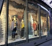 Holiday window display uses vinyl and custom die cut paper