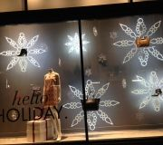 Holiday window graphics are custom made with precision cutting to shape of acrylic and fabricated with LED lights