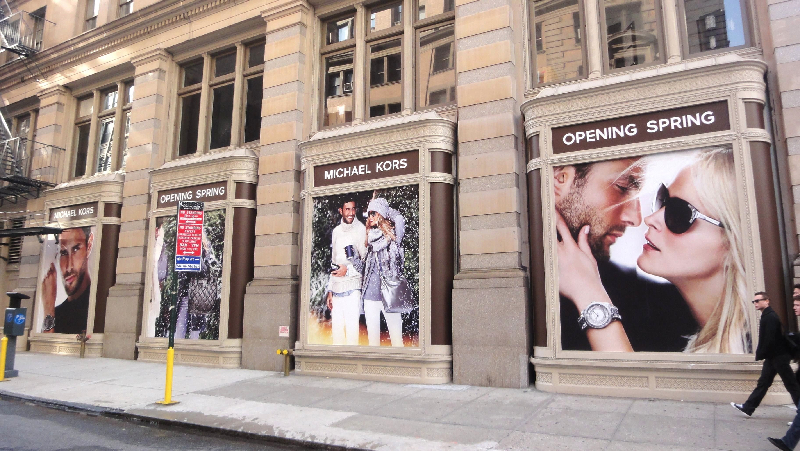 Large format graphics are used to cover windows on fifth ave nyc