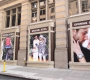 large format graphics are used to cover windows on fifth ave., NYC.